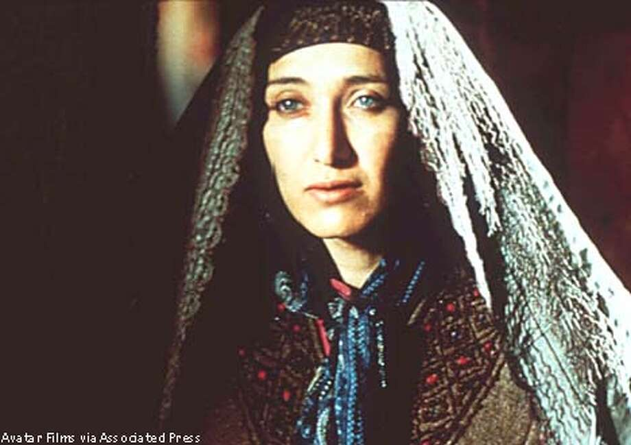 Nelofer Pazira in 'Kandahar,' which is about a woman who sneaks into Taliban-controlled Afghanistan to prevent her sister's suicide. Avatar Films photo via Associated Press
