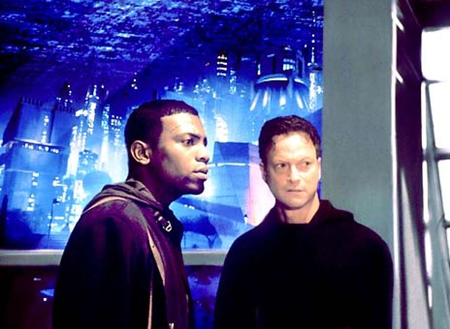 THIS IS A HANDOUT IMAGE. PLEASE VERIFY RIGHTS. Mekhi Phifer, left, and Gary Sinise in IMPOSTER Photo: HANDOUT