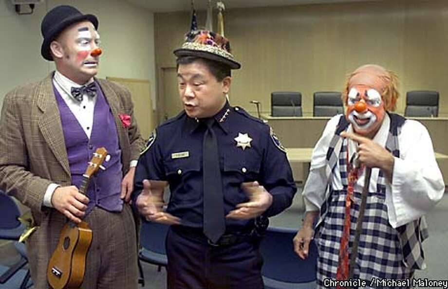 "SF Police Chief Fred Lau is the subject of clowns amusement as he conducts a press conference to promote ""Chiefs Night at the Circus"". The annual event allows several hundred low income children to attend the Ringling Brothers and Barnum and Bailey Circus. The circus clowns are Sean Hartman (left) and Mitch Freddes.  CHRONICLE PHOTO BY MICHAEL MALONEY Photo: MICHAEL MALONEY"