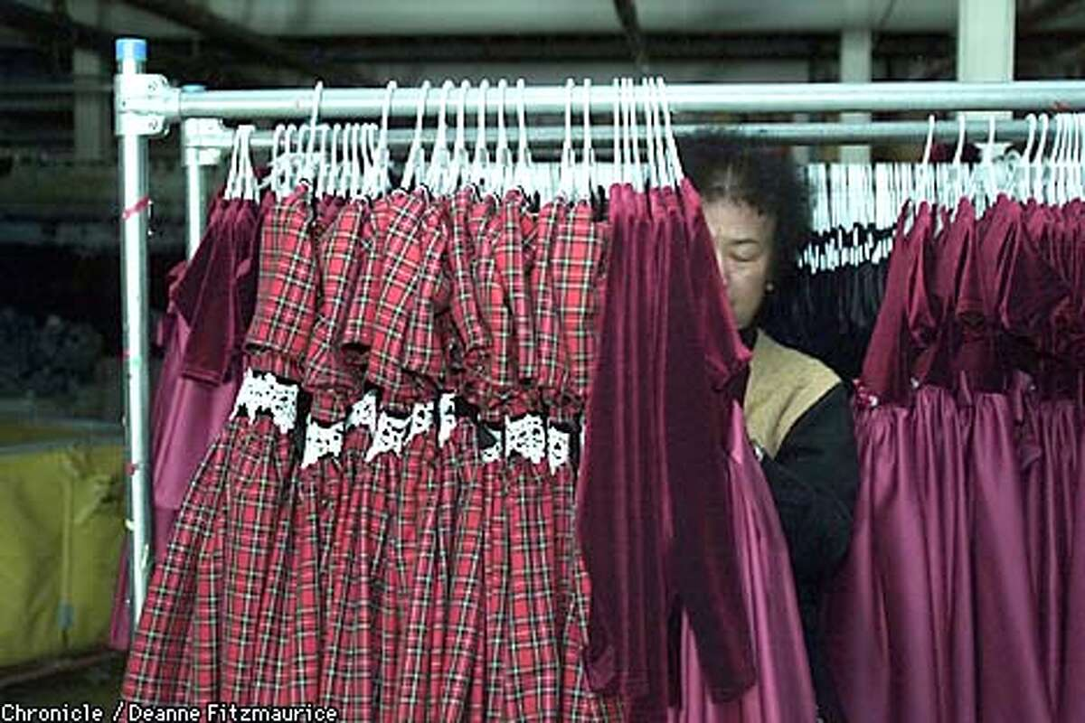 A worker at Wins of California garment factory in San Francisco sorts clothing in the basement. CHRONICLE PHOTO BY DEANNE FITZMAURICE