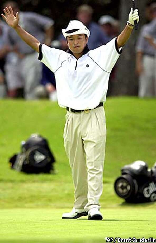 Shingo Katayama raises his arms as his golf ball drops in the cup for birdie on the 18th hole during the second round of the on Friday, Aug. 17, 2001, in Duluth, Ga. Katayama shot a 6-under-par 64. (AP Photo/Atlanta Journal-Constitution, Brant Sanderlin) Photo: BRANT SANDERLIN