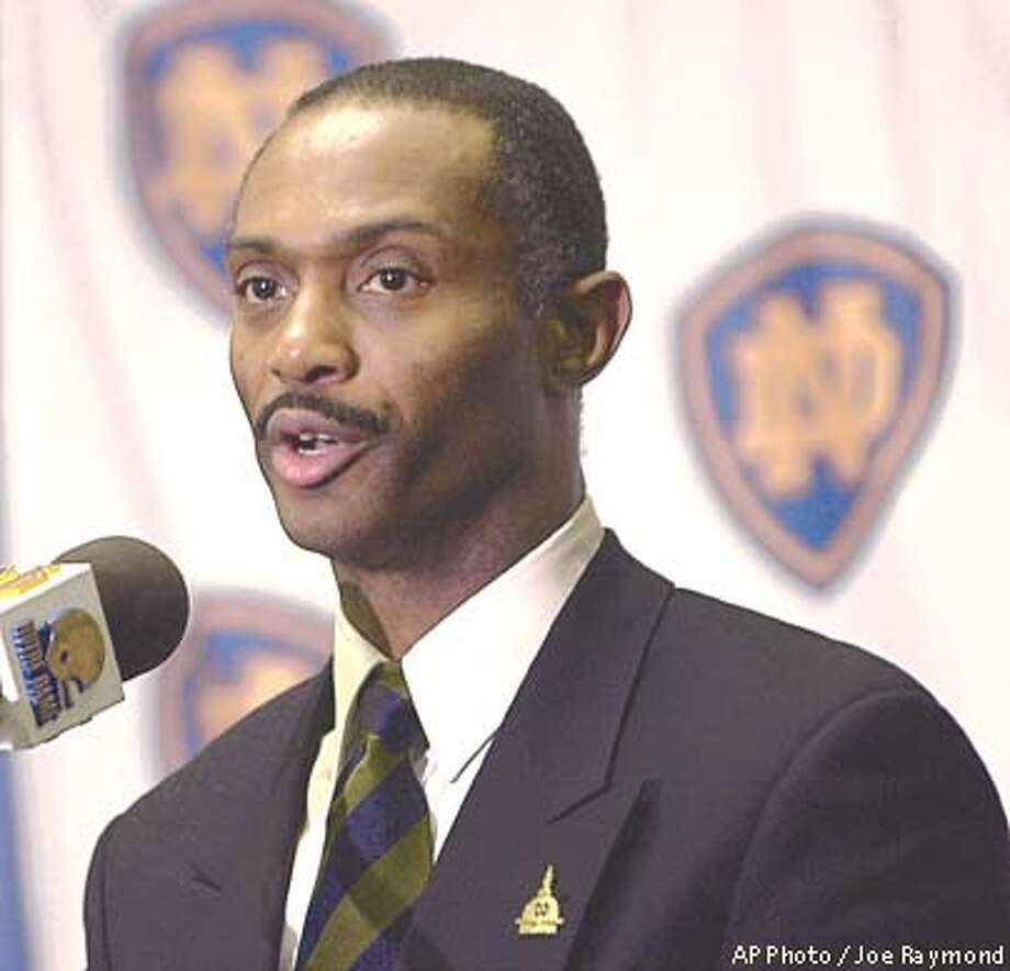 Tyrone Willingham talks with the media at a press conference Tuesday Jan. 1, 2002 in South Bend, Ind. Willingham was named the head coach of Notre Dame football team Monday. (AP Photo / Joe Raymond) Photo: JOE RAYMOND