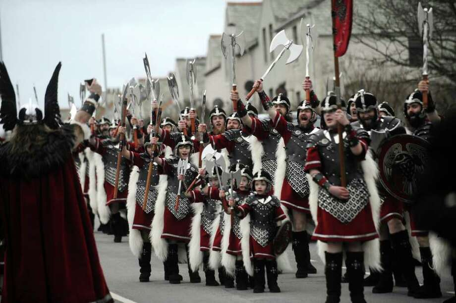 Participants dressed in armour and holding Viking war-axes and shields take part in a procession during the annual Up Helly Aa festival in Lerwick, Shetland Islands. Photo: ANDY BUCHANAN, AFP/Getty Images / AFP