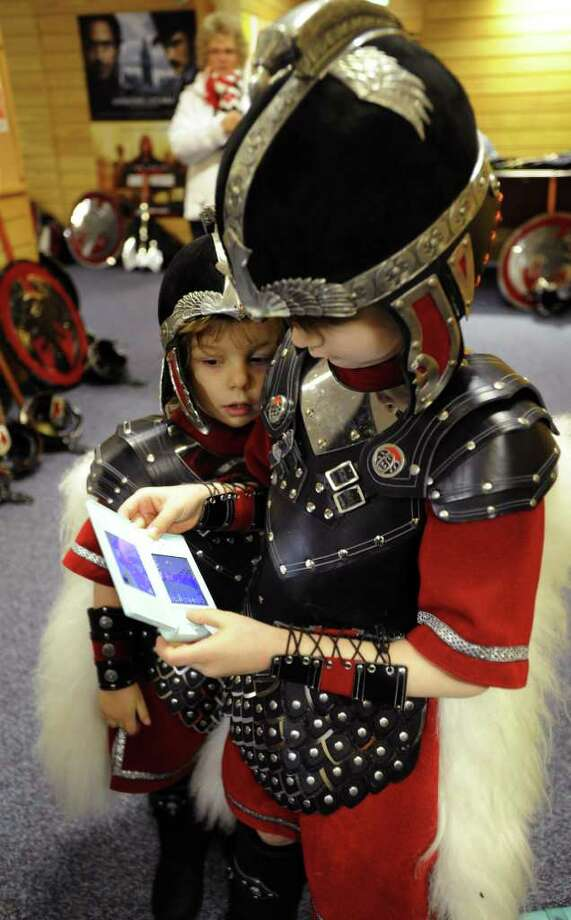 Young 'Jarl Squad' members Murray Shearer (L) and his brother Logan (R) play dressed in their Viking armour before the start of the annual Up Helly Aa festival in Lerwick, Shetland Islands. Photo: ANDY BUCHANAN, AFP/Getty Images / AFP