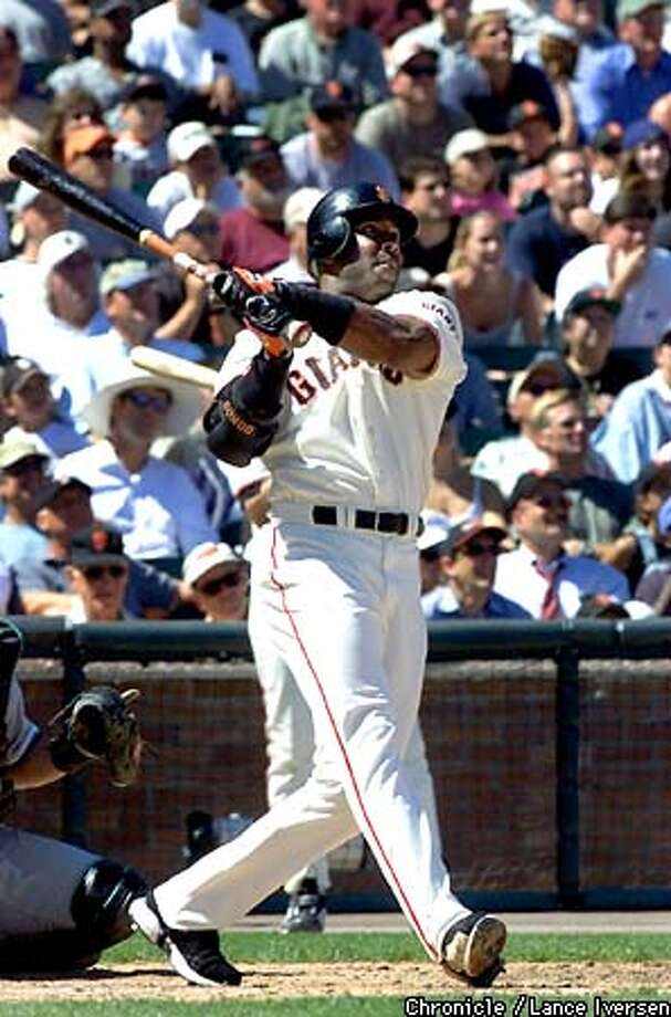 Barry Bonds follows the flight of his 8th inning three run homer over the 421 mark in center field thursday. Giants win over the Florida Marlins 5-3. BY LANCE IVERSEN/SAN FRANCISCO CHRONICLE Photo: LANCE IVERSEN