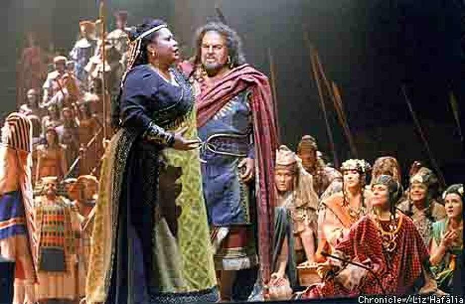 San Francisco Opera presents Verdi's 'Aida' at Bill Graham Civic Auditorium. Aida is played by Michele Crider and her father Amonasro is played by Timothy Noble. Liz Hafalia Photo: LIZ HAFALIA