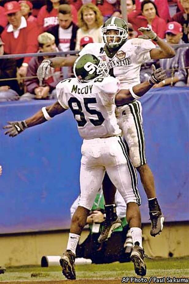 Michigan State wide receiver Charles Rogers, right, is congratulated by tight end Ivory McCoy after Rogers scored against Fresno State in the second quarter in the , Monday, Dec. 31, 2001 in San Jose, Calif. (AP Photo/Paul Sakuma) Photo: PAUL SAKUMA