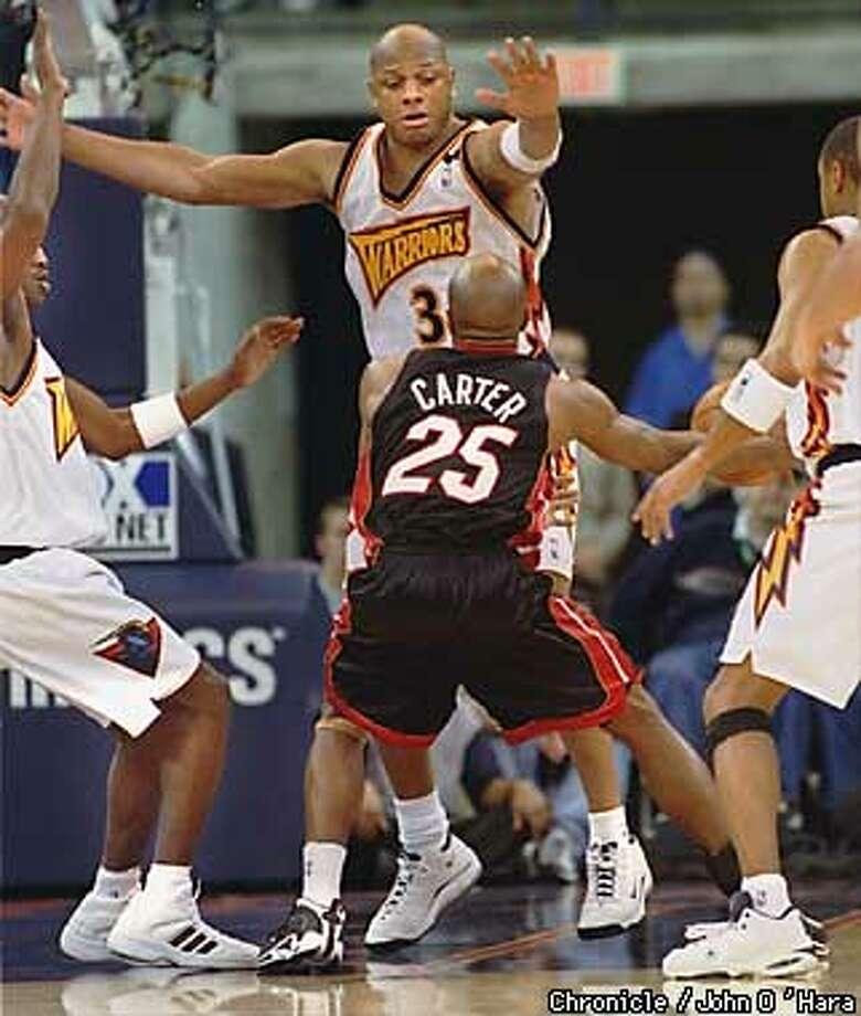 """Oakaland, Ca. Oakland Arena  Golden State Warriors V/S Miami Heat  Warriors Terry Cummings , 6' 9"""" defends against Anthony Carter, 6'-1""""  Photo by............John O'Hara Photo: John O'Hara"""