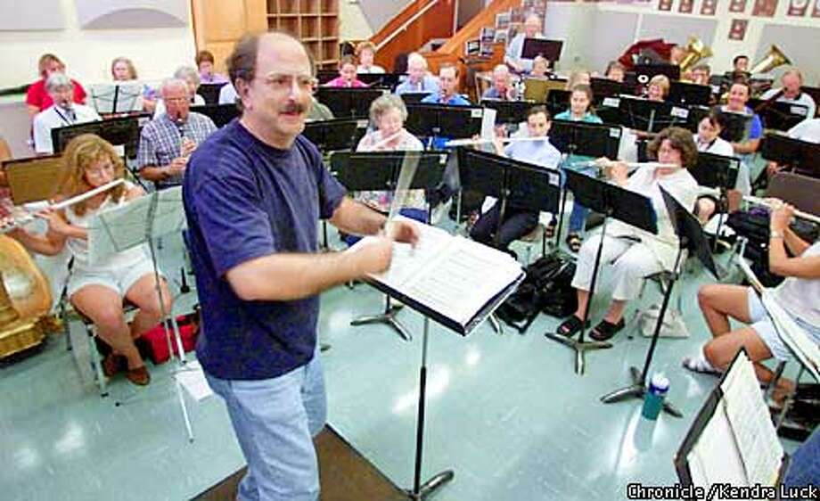 Harvey Benstein conducts a number during rehearsal of the Walnut Creek Concert Band. Benstein is the area very own Music Man, he is head of the Campolindo High School music program, as well as the Contra Costa Chamber Orchestra and the Walnut Creek Concert Band. (KENDRA LUCK/SAN FRANCISCO CHRONICLE) Photo: KENDRA LUCK
