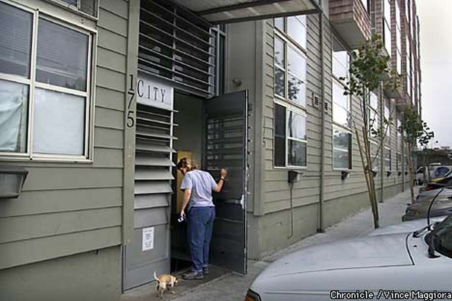 Deetta Branan a resident of the City Lofts at 175 Bluxome st. SF where a robbery place and two people where shot.  by Vince Maggiora Photo: VINCE MAGGIORA