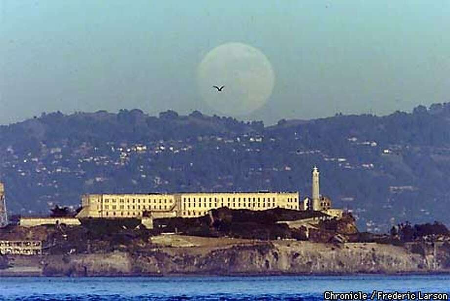 San Francsico�s Alcatraz Island and the December Full moon highlighted the Winter Solstice, the longest night of the year. Tuesday (12-21) full moon appeared 14% bigger than usual. However, it is also only ten days from the Earth's perihelion, its closest point to the Sun. Since the Moon shines with reflected sunlight, the moon appeared 7% brighter than usual. These events occurring together are extremely rare. This is probably the biggest, brightest moon of the Millenium as well as its last. Chronicle photo by Frederic Larson Photo: FREDERIC LARSON