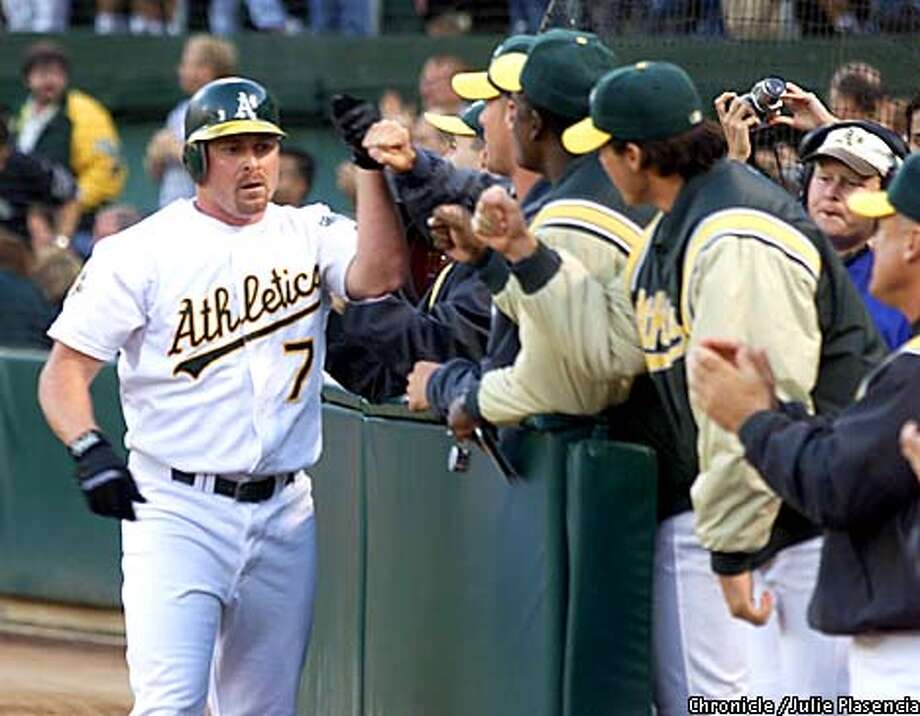 Jeremy Giambi of the Oakland Athletic's is congratulated by teammates after hitting a home run against the New York Yankee's at the Network Collesium in Oakland.  (JULIE PLASENCIA/SAN FRANCISCO CHRONICLE) Photo: JULIE PLASENCIA