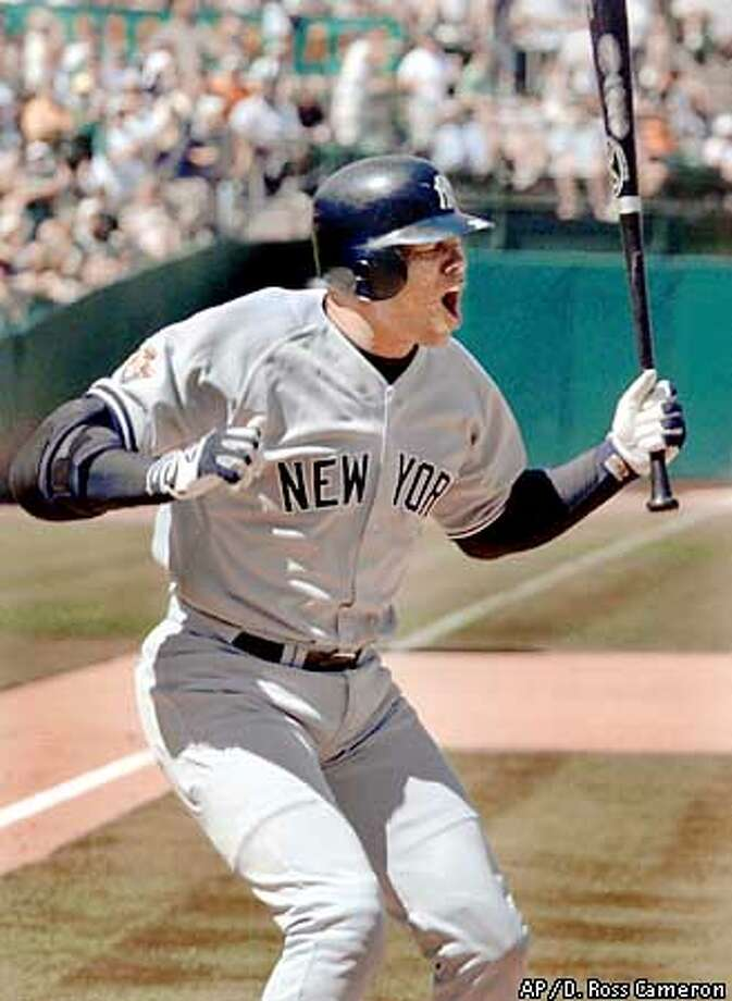 New York Yankees designated hitter David Justice reacts to being called out on strikes to end the top of the ninth inning against the Oakland Athletics, Sunday, Aug. 12, 2001, in Oakland, Calif. The A's won the game, 4-2. (AP Photo/D. Ross Cameron) Photo: D. ROSS CAMERON