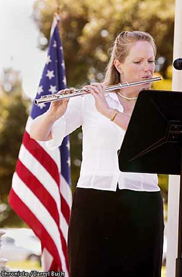 """Pamela Ravenelle plays a flute solo during the Oakland Municipal Band """"Swings the Thing"""" concert at the Lakeside Park bandstand near Lake Merritt. Chronicle Photo by Darryl Bush Photo: Darryl Bush"""