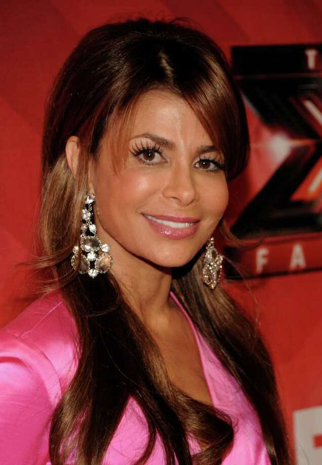 """FILE - In this Dec. 22, 2011 file photo, singer Paula Abdul poses on the red carpet at The X Factor Finale show in Los Angeles. Abdul said she's leaving """"The X Factor"""" after one season as judge. (AP Photo/Dan Steinberg, file) Photo: Dan Steinberg / AP2011"""