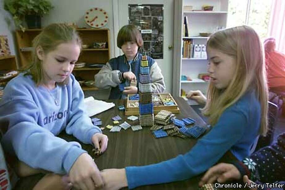 Advanced elementary students Stephanie Huhn, Jerry Alexander-Byrnes, and Amy Buck explore mathematics by building a decanomial tower at Concordia School, a Montessori school in Concord, CA.  2353 Fifth Avenue - Concord, CA PHOTO BY JERRY TELFER/THE CHRONICLE Photo: JERRY TELFER