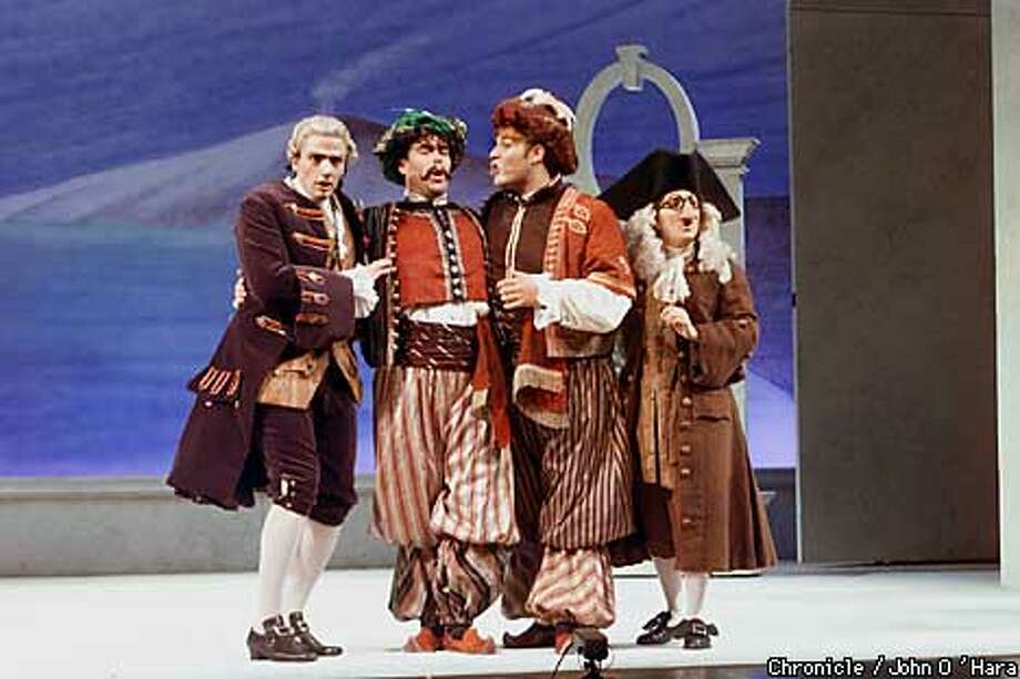 "Yerba Buena Center for the Arts  Opera, ""Cosi fan tutte"" by Mozart  Despina: Saundra DeAthos (right)  Ferrando: Bryan Hymel (3rd lft) Guglielmo: Brad Alexander(2nd,lft)  Don Alfonso: Matthew Trevi�o (left)  photo/John O'Hara Photo: John O'Hara"