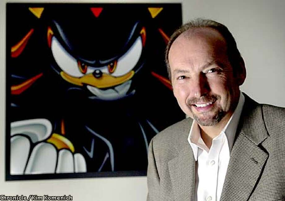 "SEGA COO Peter Moore in the San Francisco headquarters with poster of ""Shadow"" the evil twin of SEGA game hero, ""Sonic Hedgehog."" CHRONICLE PHOTO BY KIM KOMENICH Photo: Kim Komenich"