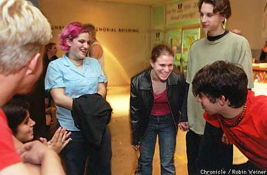 (l to r) Adrian Heideman, 17, Melissa Shahbazian, 17, Sarah Goldstein, 17, Jenny Rosenfeld, 17, Brent Primrose, 18, and Chris Webster, 17, congregate outside the YWCA in Palo Alto during a break in between bands during a Youth Music Foundation event.  BY ROBIN WEINER/FOR THE CHRONICLE  ONE TIME USE ONLY Photo: ROBIN WEINER