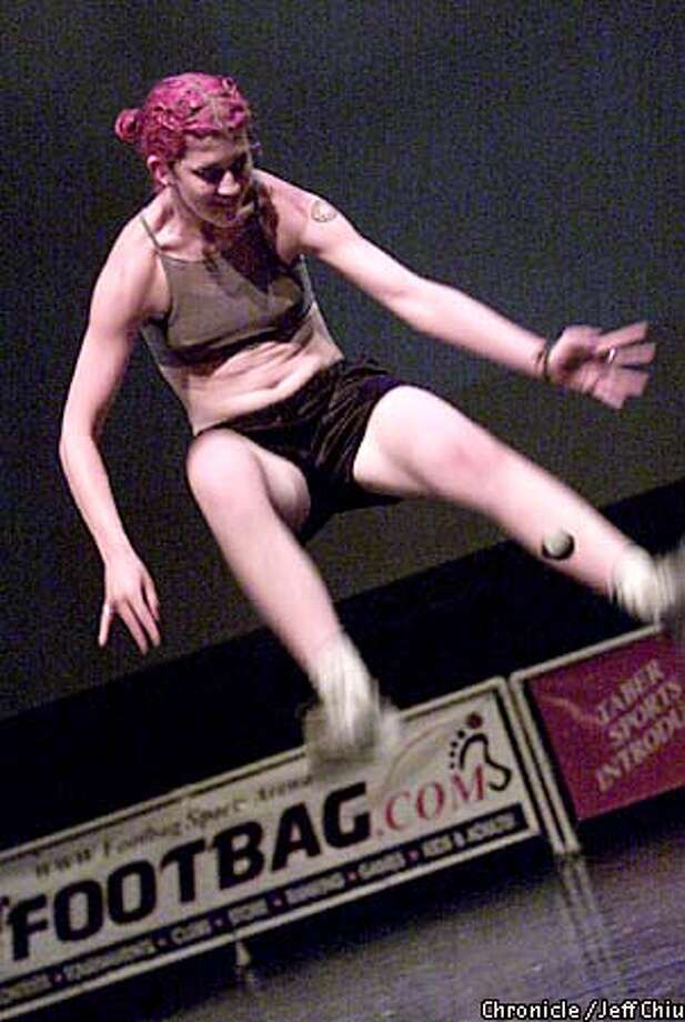 Judith Lyn Arney performs her freestyle footbag routine during the 2001 World Footbag Championships at the Theater Artaud in San Francisco on Thursday night. Photo by Jeff Chiu / The Chronicle. Photo: Jeff Chiu