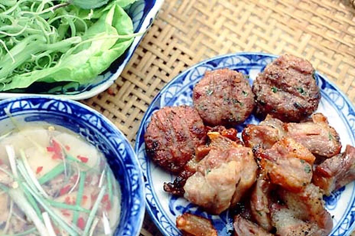 Diners assemble Hanoi-style rice noodles with grilled pork at the table. Photo by Mai Pham, special to the Chronicle