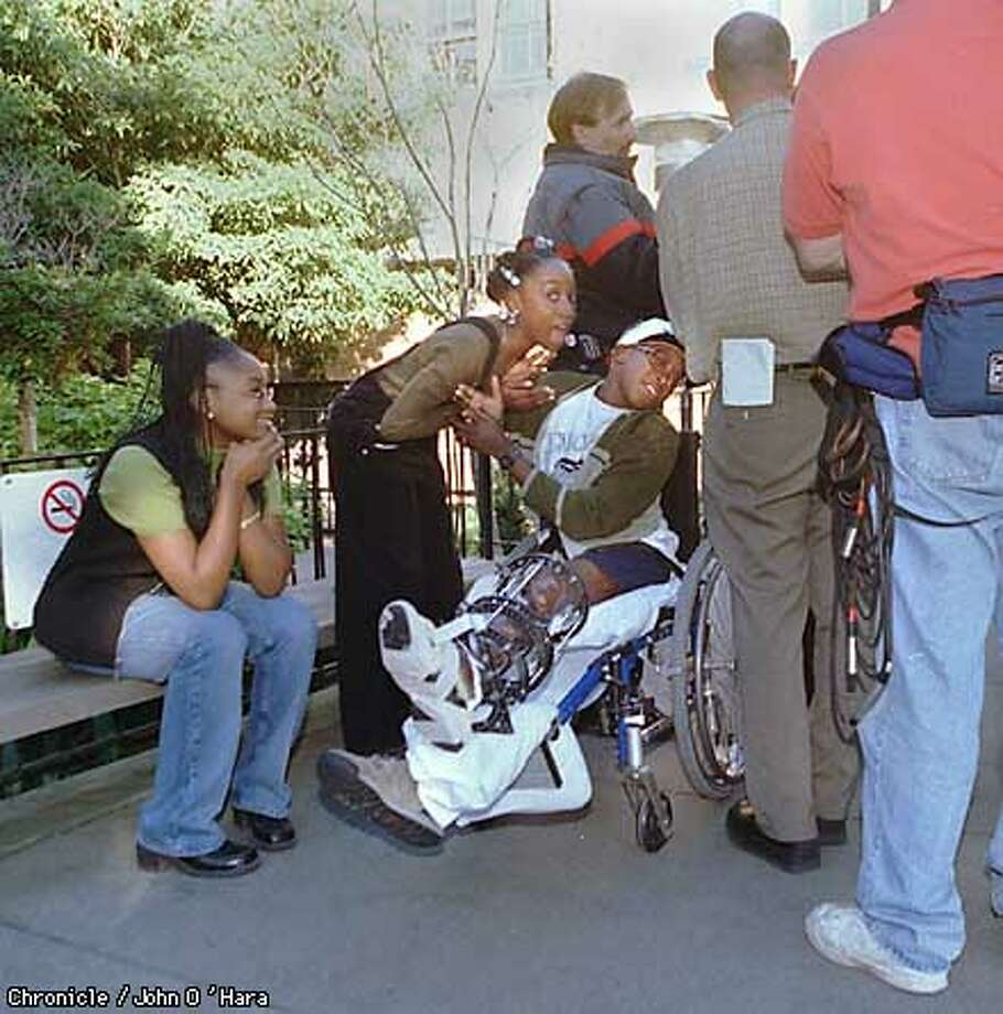 "Oakland, CA. ""Childern's Hospital"" 747- 52nd st.  Patrick O'Neal Dawson in wheel chair is going home. He has been in Hospital since Feburary. Marisha, Patrick's sister plays around with him while the media interviewed the therapist. His niece Tanae (cq) is at left.  Photo by..........John O'Hara Photo: John O'Hara"