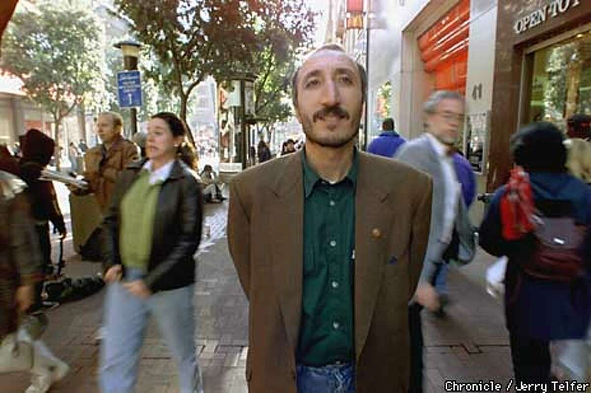 Turkish teacher Mahir Cagri strolls along Powell Street on a visit to SF. Cagri's web page became a WWWevent after it was kidnapped, relocated on the web, and generated more than a million hits. PHOTO BY JERRY TELFER/THE CHRONICLE