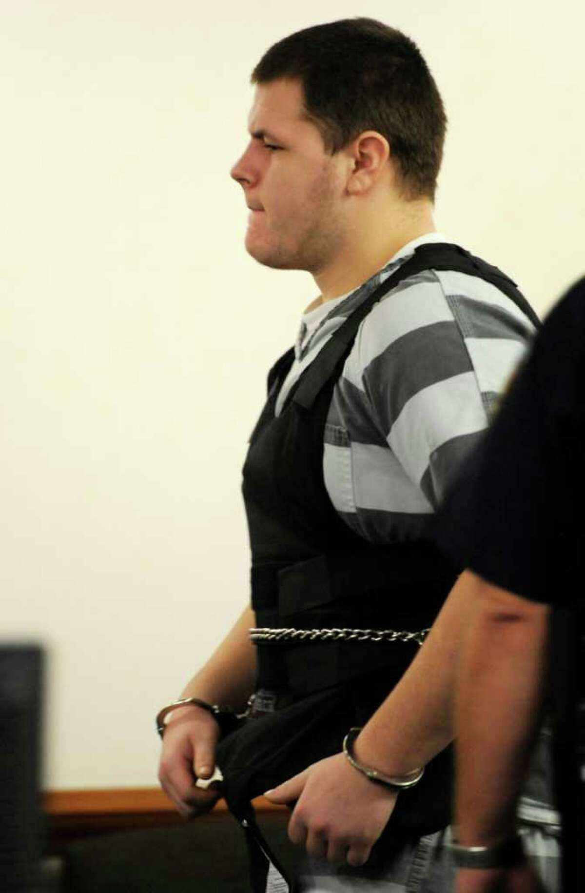 Matthew Slocum leaves courtroom after his arraignment on murder and arson in Washington County Court in Fort Edward, N.Y. September 28, 2011. (Skip Dickstein / Times Union)