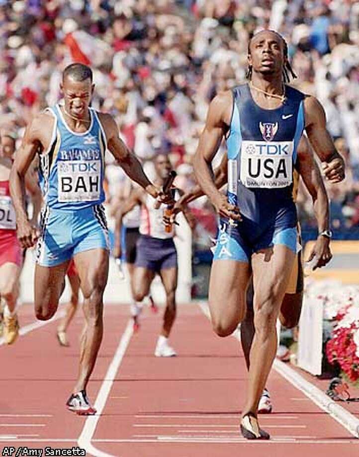 Angelo Taylor, right, of the United States, anchors his team to win the 4x400 meters relay Sunday, Aug. 12, 2001, at the World Track & Field Championships at Commonwealth Stadium in Edmonton, Alberta. Bahama's Timothy Munnings, left, finishes second. (AP Photo/Amy Sancetta) Photo: AMY SANCETTA