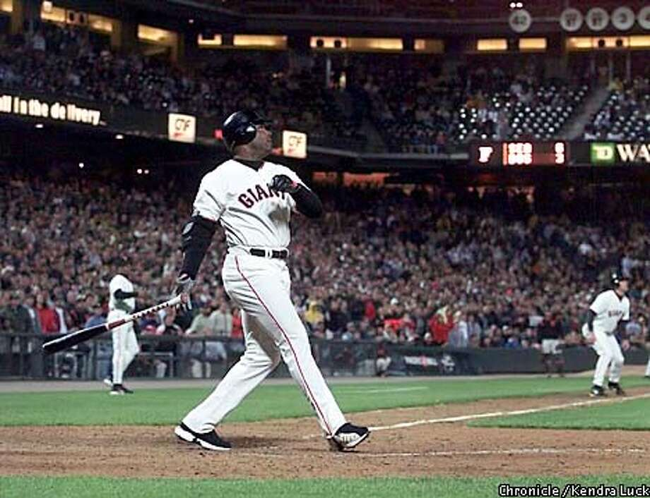 Giants slugger, Barry Bonds watches his bottom of the sixth inning grand slam hit leave the park during the Giants game against the Florida Marlins on Tuesday, August 14, 2001, at Pac Bell Park. (KENDRA LUCK/SAN FRANCISCO CHRONICLE) Photo: KENDRA LUCK