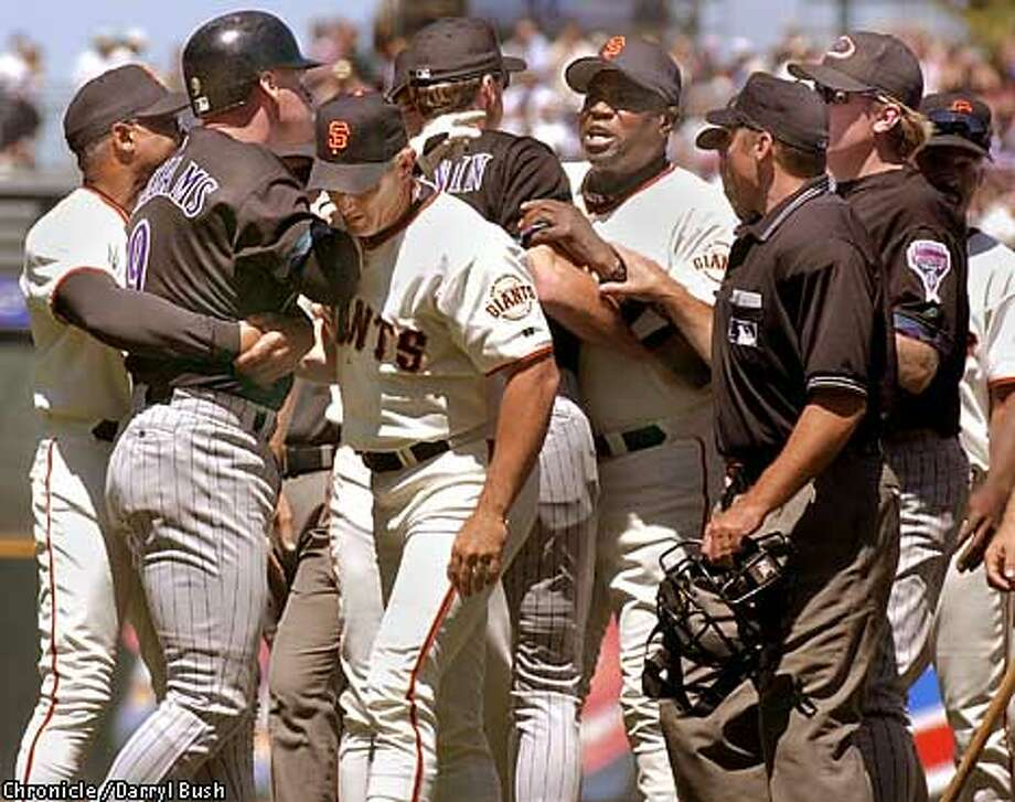 GIANTS23A-C-22JUL01-SP-DB Arizona's Matt Williams, left, is held back by Giant's coaches as he charges the mound and Giants manager Dusty Baker, back center, yells back at him in the sixth inning after a pitch nearly hit Williams, thrown by Giants pitcher Chad Zerbe. Chronicle Photo by Darryl Bush Photo: Darryl Bush
