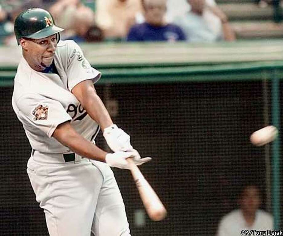 Oakland Athletics batter Jermaine Dye smacks a three-run home run off Cleveland Indians pitcher C.C. Sabathia in the third inning Thursday, August 2, 2001 at Jacobs Field in Cleveland. (AP Photo/Tony Dejak) Photo: TONY DEJAK
