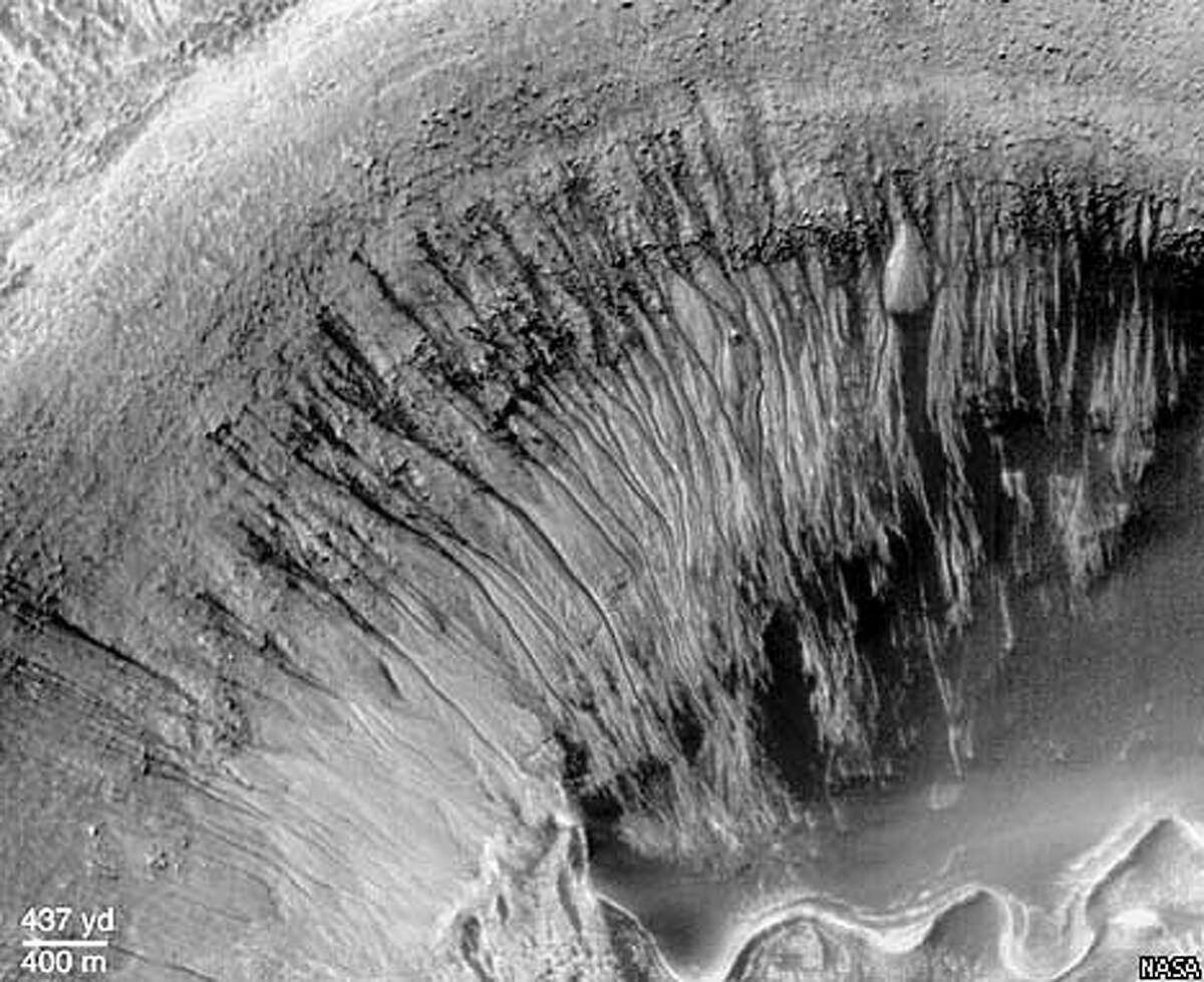 Narrow channels rim the edge of a crater inside the larger Newton Crater. NASA Photo