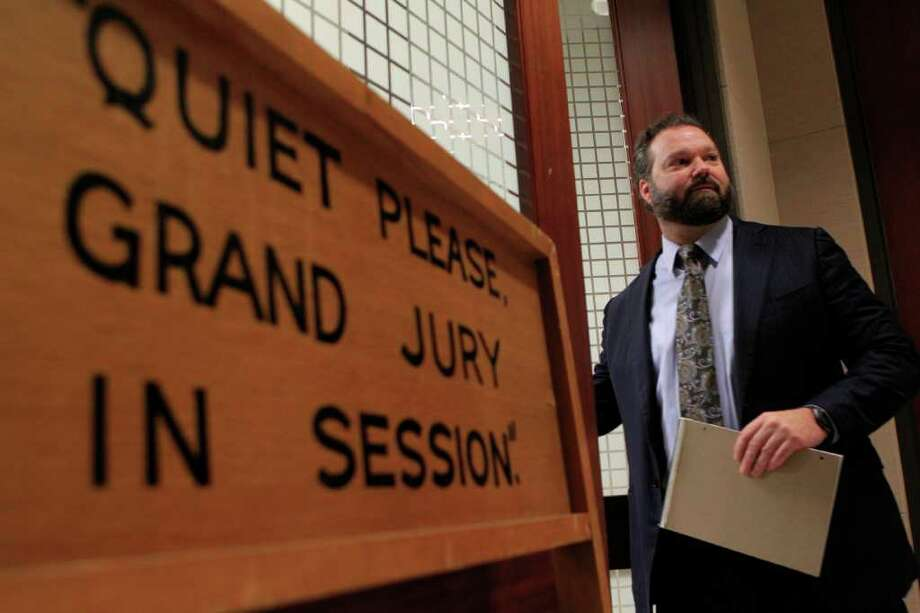 "Chip Lewis, attorney for former Houston Police Department lab supervisor Amanda Culbertson, described the conduct of the Harris County District Attorney's office as ""disgraceful"" after a grand jury closed down its investigation Tuesday into possible problems with HPD's breath alcohol testing vans. Photo: Johnny Hanson / © 2012  Houston Chronicle"