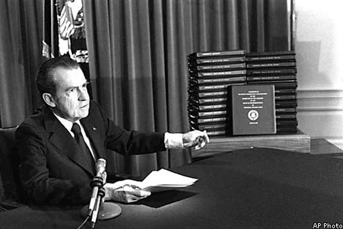 FILE--President Nixon gestures toward transcripts of White House tapes after announcing he would turn them over to House impeachment investigators and make them public in April of 1974. Copies of President Nixon's tapes wound around 5,000 plastic reels will be shredded and burned in the next few months because they contain personal and political talk the court says the public isn't allowed to hear. (AP Photo/Files)