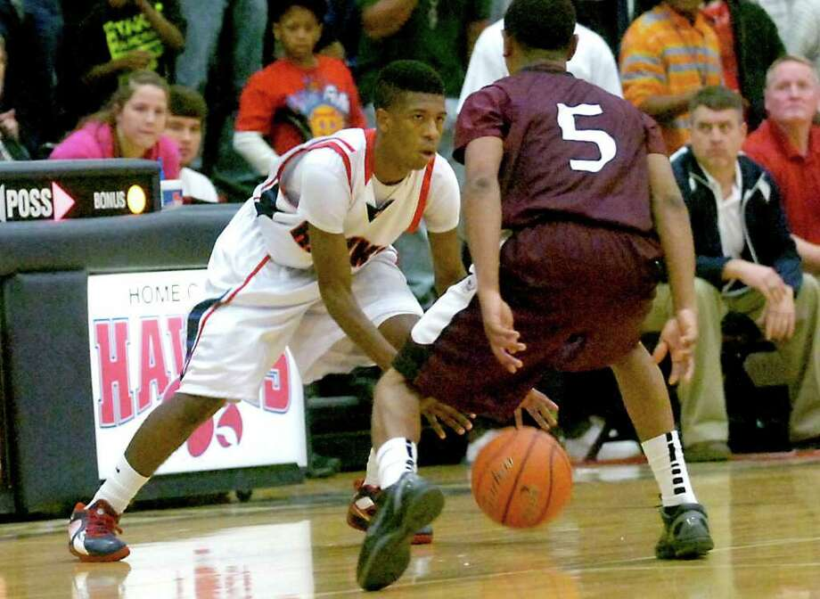 H-J's Sammy Mitchell controls the ball as Silsbee's Danti Wilson defends at Hardin-Jefferson High School in Sour Lake, Tuesday, January 31, 2012. Tammy McKinley/The Enterprise Photo: TAMMY MCKINLEY