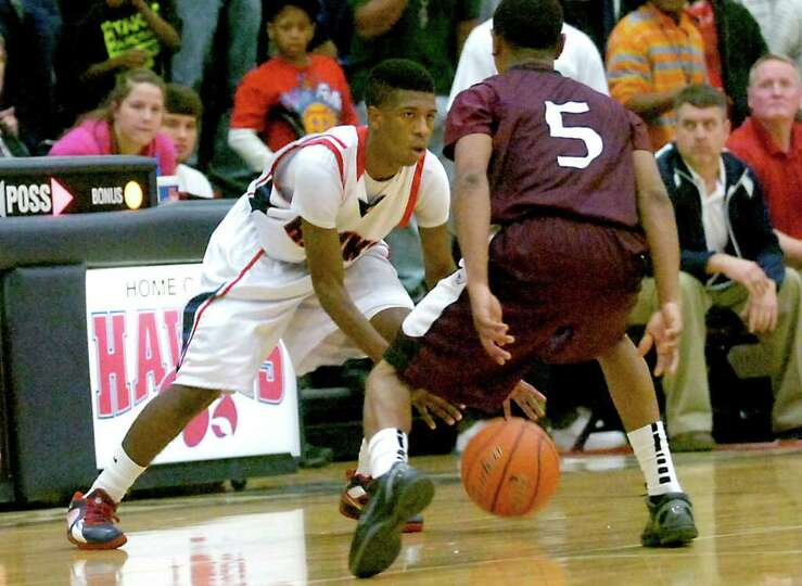 H-J's Sammy Mitchell controls the ball as Silsbee's Danti Wilson defends at Hardin-Jefferson High Sc