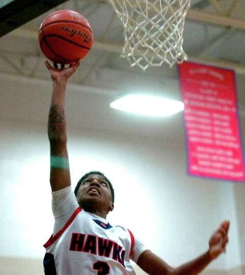 Hardin-Jefferson's Devante Johnson goes up for the basket during the game against Silsbee at Hardin-