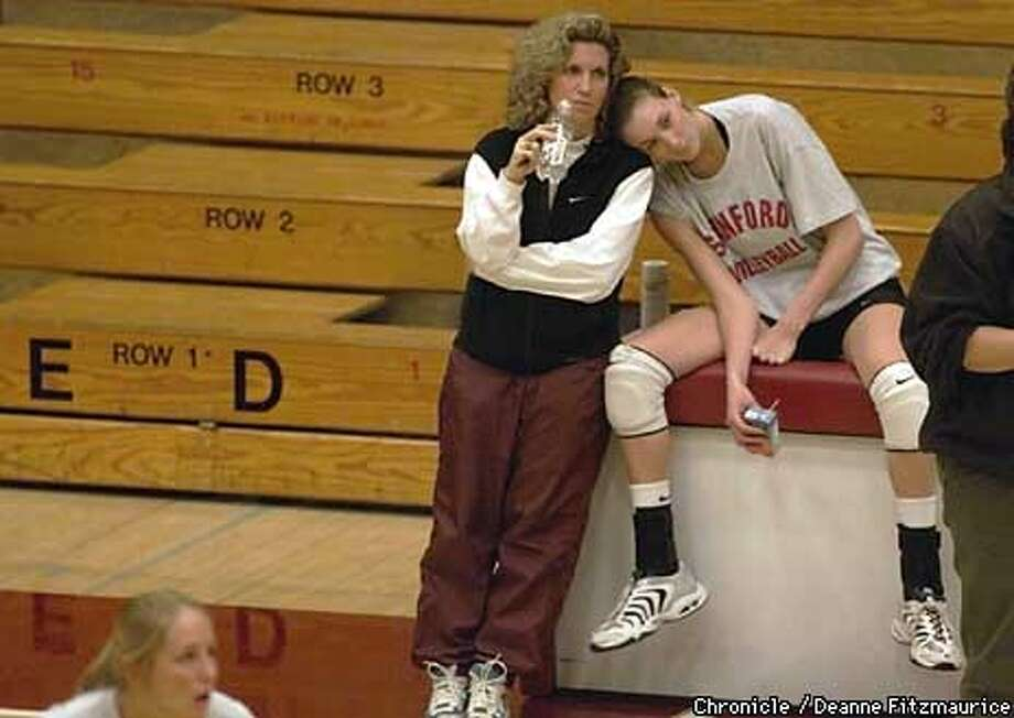 Kerri Walsh takes a timeout during practice and rests her head on the shoulder of a Stanford staff member in Maples Pavilion.  CHRONICLE PHOTO BY DEANNE FITZMAURICE Photo: DEANNE FITZMAURICE