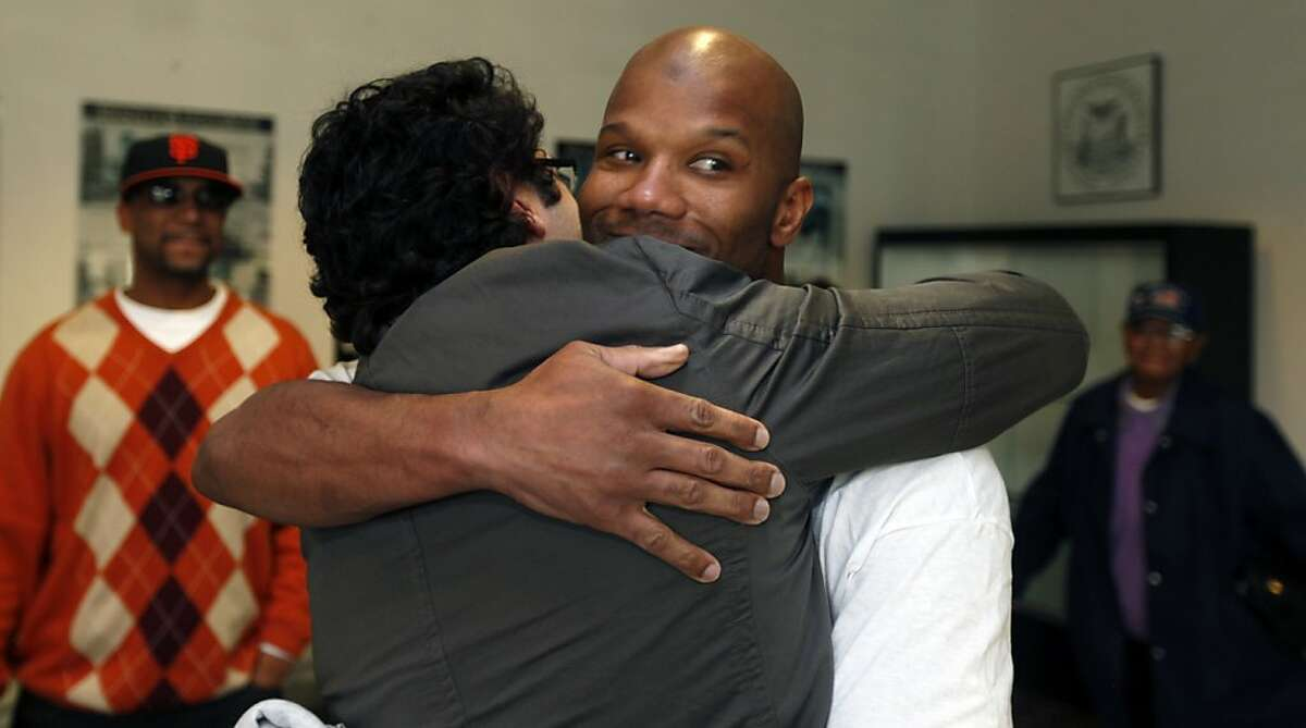 Attorney Zachary F. Bookman hugs Caramad Conley, who a judge said last month had been wrongfully convicted of a 1989 double murder in San Francisco. Conley walked out of San Francisco County jail Wednesday Jan 12, 2011 a free man. San Francisco's new DA George Gascon decides not to retry him.
