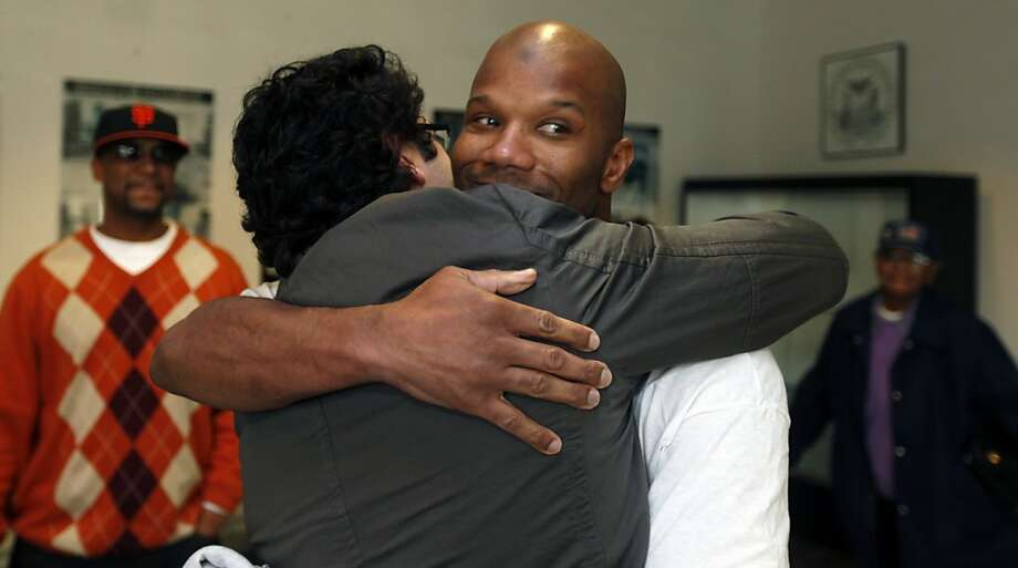 Attorney Zachary F. Bookman hugs Caramad Conley, who a judge said last month had been wrongfully convicted of a 1989 double murder in San Francisco.  Conley walked out of San Francisco County jail Wednesday Jan 12, 2011 a free man. San Francisco's new DA George Gascon decides not to retry him. Photo: Lance Iversen, The Chronicle