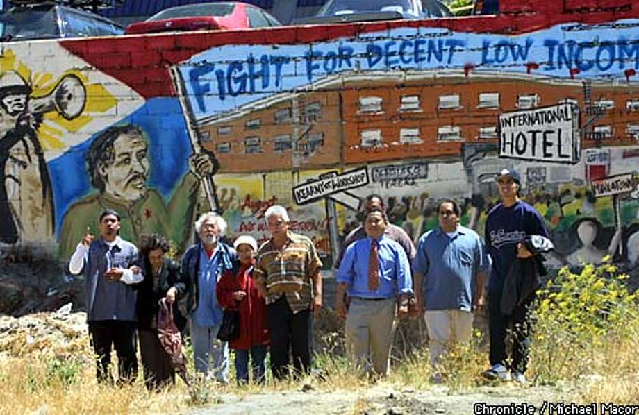 "Members of the Manillatown Heritage Foundation gathered at the site as it looks today with a recent mural painted on one of the wall that tells the story of the stuggle to develope the property. August 4th marks the 24th anniversary of the evictions at the ""I Hotel"" on Kearny St. , San Francisco. by Michael Macor/The Chronicle Photo: MICHAEL MACOR"