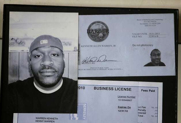 Warren hangs next to his barbers license at his uncles barber ...