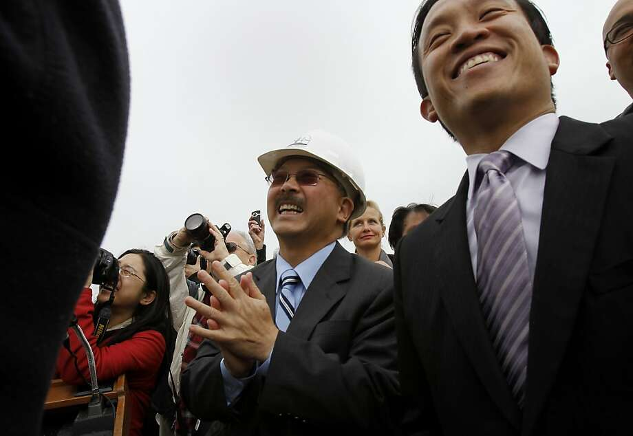 San Francisco Mayor Ed Lee (center) and Board president David Chiu smiled as they watched a hole be punched into the side of Pier 27 as a gesture that demolition is beginning. A ceremony was held at the rear of Pier 27 in San Francisco, Calif. where a new cruise ship terminal will be built and a public viewing area for the America's Cup yacht races. Photo: Brant Ward, The Chronicle