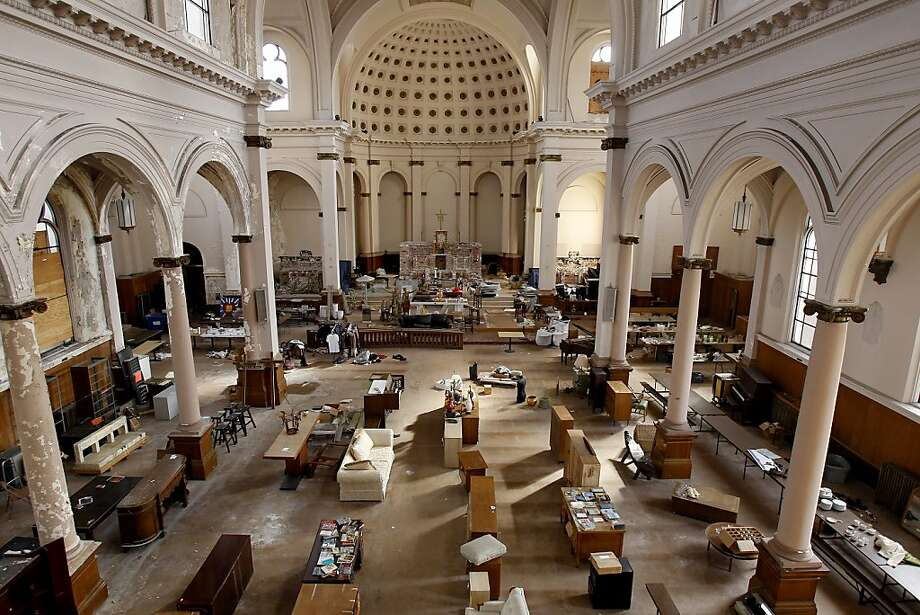 Much of the floor of the church is littered with old furniture left by the church.  There have also been some rummage sales in the space. St. Joseph's Church, a historic landmark built in 1913 in San Francisco, Calif., has been vacant since the earthquake of 1989.  Now a developer wants to reopen the church, after completing seismic upgrades, as office and retail space. Photo: Brant Ward, The Chronicle