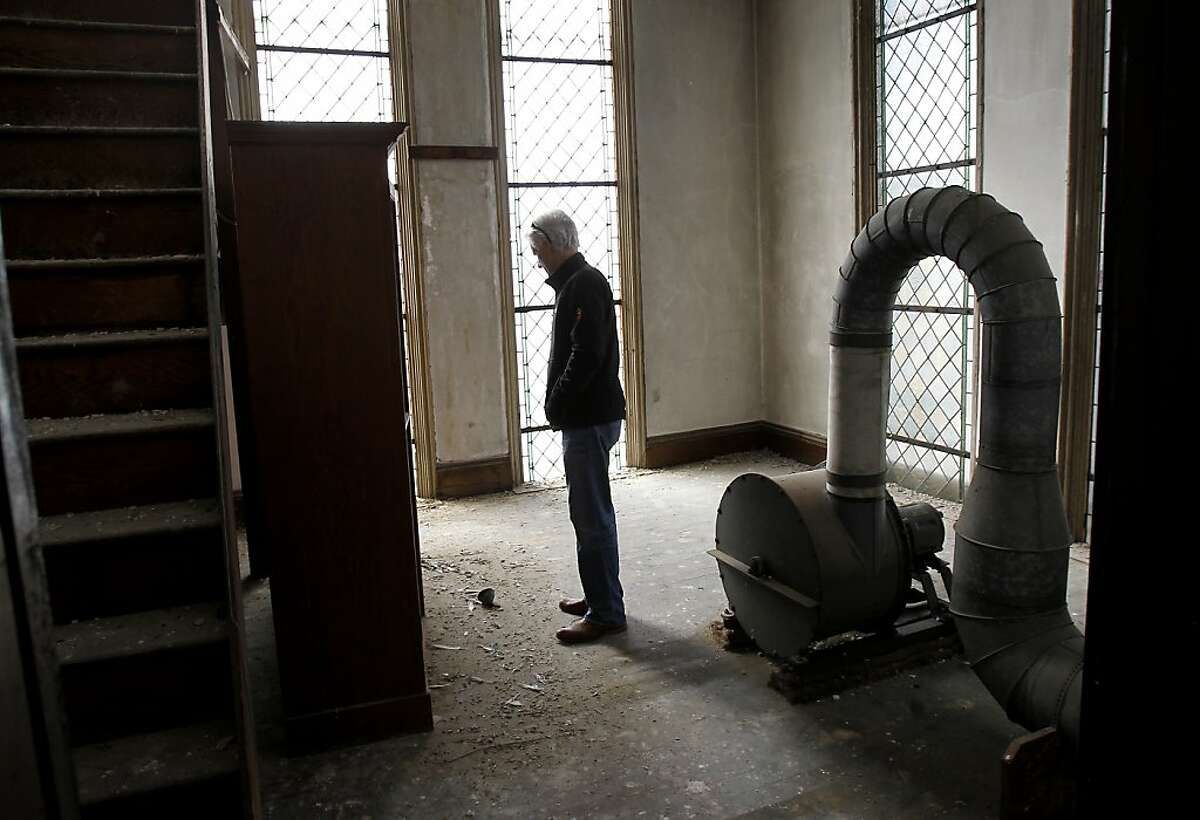 Developer Brian Spiers stops to look at the skeleton of a pigeon in a back room. The church was full of pigeons and the homeless at one point. St. Joseph's Church, a historic landmark built in 1913 in San Francisco, Calif., has been vacant since the earthquake of 1989. Now a developer wants to reopen the church, after completing seismic upgrades, as office and retail space.