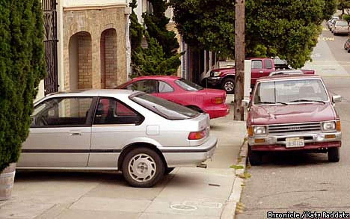 Photo by Katy Raddatz--The Chronicle Story about parking across sidewalks. SHOWN: an automotive obstacle course on Shrader St.