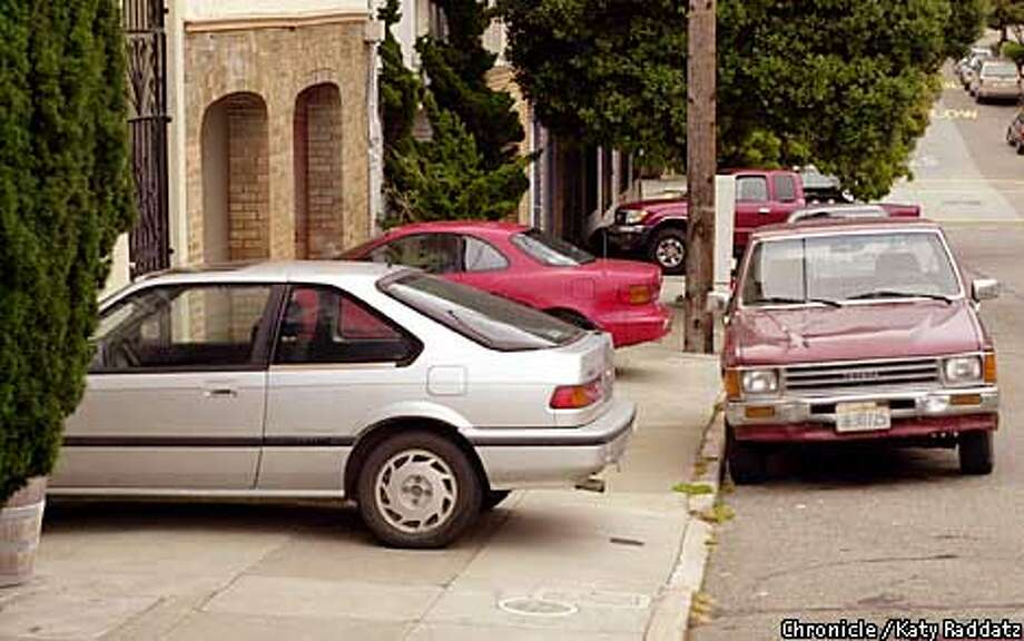 Photo by Katy Raddatz--The Chronicle  Story about parking across sidewalks. SHOWN: an automotive obstacle course on Shrader St. Photo: KATY RADDATZ