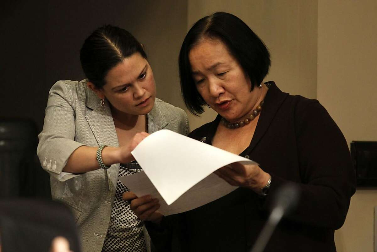 Budget director, Sabrina Landreth, (left) and Mayor Jean Quan look over papers as the Oakland City Council listens to public input as the council prepares to vote on making a drastic $28 million cut to its current budget, eliminating about 100 jobs in a major city reorganization prompted by the loss of redevelopment funds. in Oakland, Ca. on Tuesday January 31, 2012.