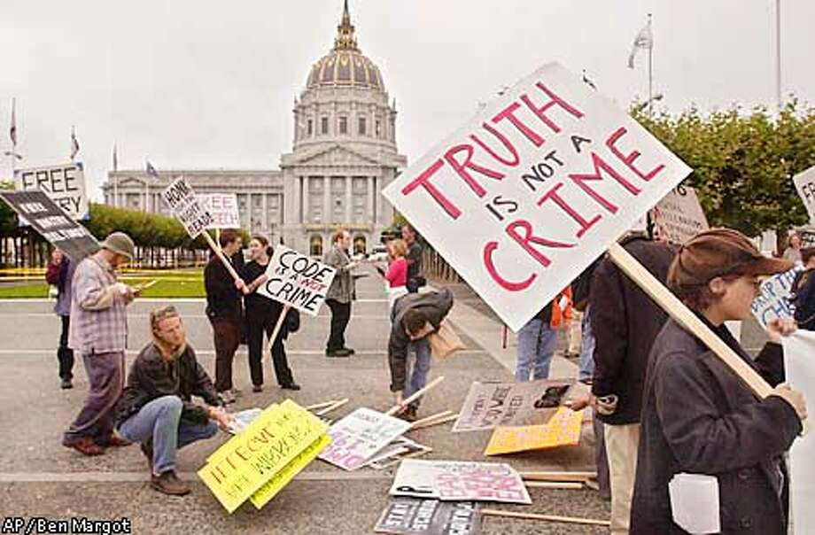 Programmers and internet freedom activists gather in front of San Francisco City Hall prior to marching to the Phillip Burton Federal Building to protest the arrest of Russian computer programmer Dmitry Sklyarov, Monday, July 30, 2001, in San Francisco. Sklyarov was jailed after developing software that allows the user to circumvent the copyright protections in Adobe Systems eBook reader program. (AP Photo/Ben Margot) Photo: BEN MARGOT